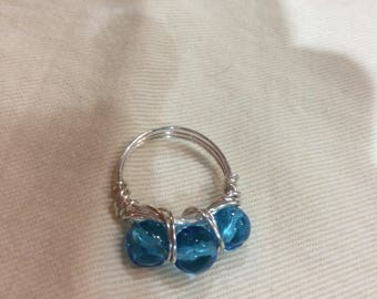 Wire wrapped ring with aqua blue glass beads