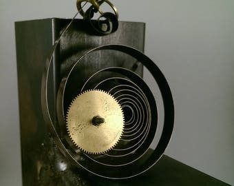 Pendant clock's dial and gears.
