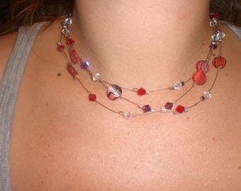 Triple stranded beaded necklace