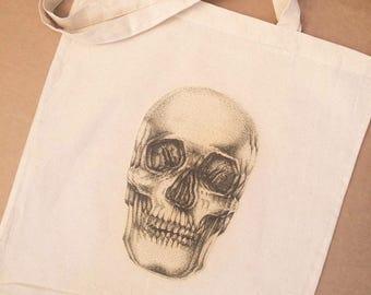 Cotton tote bag with original skull design.
