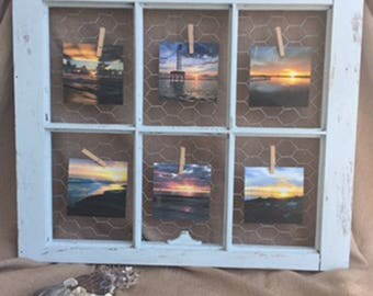 Distressed antique window with photos from beaches and river surrounding Wilmington, NC.