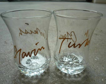 A pair of Gavin Turk'ish' gold tagged tea glasses