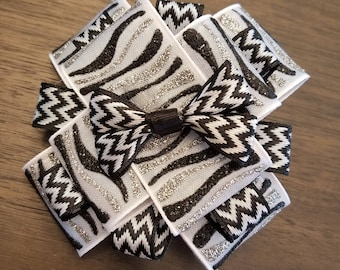 """Sparkly silver and black stacked hair bow with 2"""" French barrette."""