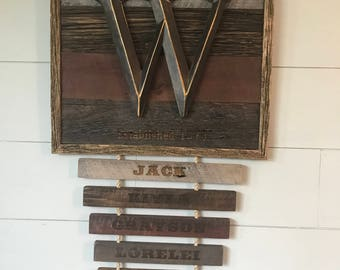 Framed monogram 100+ year old wood with name plates laser engraved