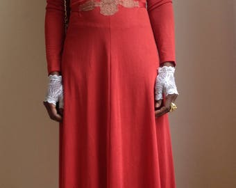 Long evening dress 1070's, coral red , embroidered with beige details.
