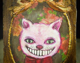 The Cheshire cat: Alice's constant companion on her Wonderland adventures appears on this original mixed media painting by Danita Art