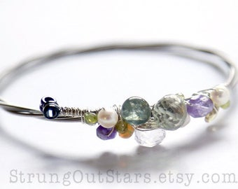 Strung-Out Guitar String Bangle with pastel gemstones