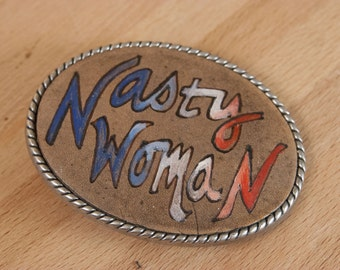 Belt Buckle -  Nasty Woman - Trophy Style Buckle in Red White and Blue - Comes With Planned Parenthood Donation