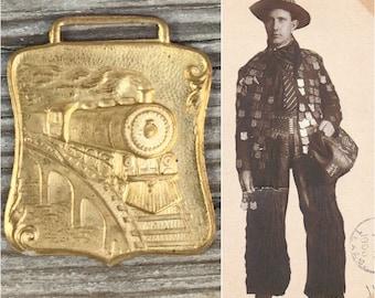 Locomotive pendant. Train fob. Railroad Nos 1970s does 1800s choo choo train jewelry men old school transportation gold brass pictoral   Zz