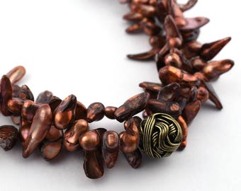 Triple strand Copper blister pearl necklace with brass woven bead