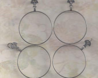 4 Vintage optical lenses with jump rings.. ready to make your own .. DIY