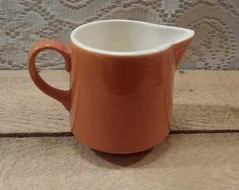 Vintage orange ceramic creamer