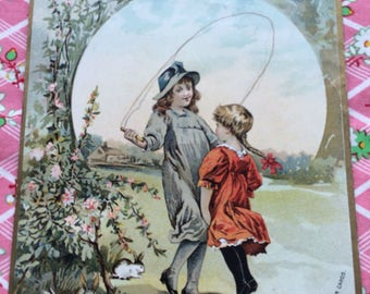 Victorian Trade Card Children Skipping Rope Bunnies Roses Lithograph McLaughlin Coffee
