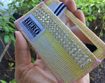 Yellow wallet made from decommissioned fire hose and embellished with Swarovski crystals!