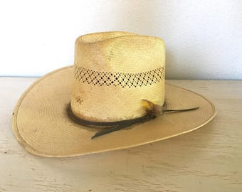 bailey hard straw hat - u rollit cowboy or cowgirl western hat - distressed and worn with feathers stuck in the band - small size 6 3/4