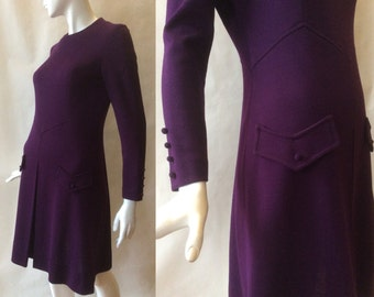 1960's rich purple knit dress, dropped chevron pointed waist, mock pockets, & long sleeves, a line skirt with kick pleat, md - lg / 10 - 12