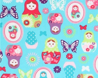 214112 turquoise with Matryoshka butterfly oxford fabric by Kokka