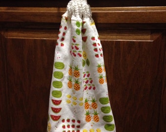 kitchen towel with a crocheted top. hand towel