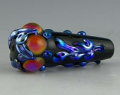 a black cone-shaped focal with bright raised silverglass designs handmade lampwork glass bead - Blue Chrome