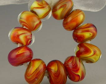a set of eleven rondelles in bright silverglass colors handmade lampwork glass beads - Lava Pools