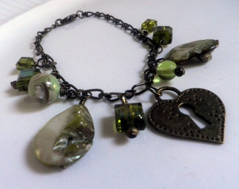 Heart of the Sea Bracelet, oxidized brass, shell and charm