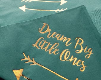 Beverage sized napkins in baby blue with gold foil.  Dream Big Little Ones with 2 arrows.