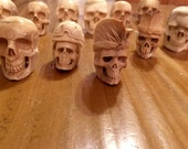 13 HUGE and Awesome hand carved skulls- each one is one of a kind- these are are undrilled sculptures