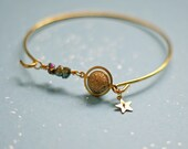 Custom orbit bangle with additional initial stamped star