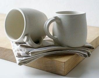 Two tankard style stoneware pottery tea mugs - glazed in vanilla cream