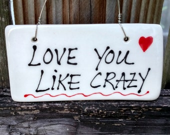 Love you like crazy hanging sign.