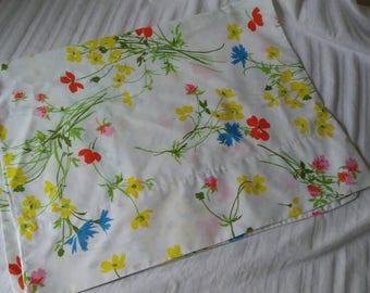 1960s handmade standard pillowcase from vintage sheet. Floral blue yellow pink orange