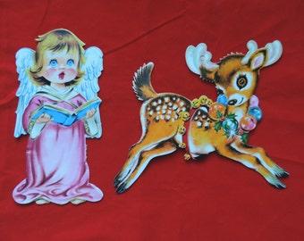 reindeer die cut Christmas decoration 1950's paper diecut Arrington reindeer and angel window hanging