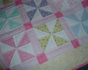 Pinwheel Baby Quilt with Hearts