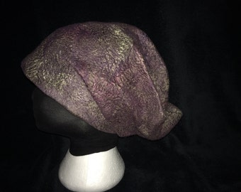 Wet felted merino wool and silk sliver slouch style hat.