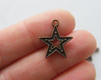 10 Star charms antique copper tone CC3