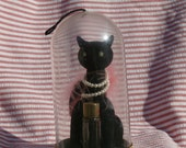 Max Factor Sophisticat Flocked Cat Figurine in Dome, Black Cat, Pear Necklace, Gem Eyes and Feathers, Originally held Golden Woods Perfume
