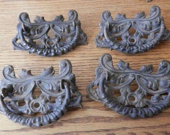 set of four (4) antique large fancy cast iron drawer pulls in 3 inch centers