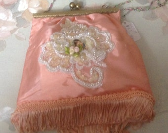 Victorian clasp purse with beaded handle with image of Victorian lady in peach