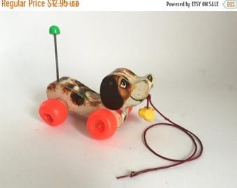 Vintage c. 1965 Fisher Price Little Snoopy Wooden Wobbly Beagle Dog Pull Toy