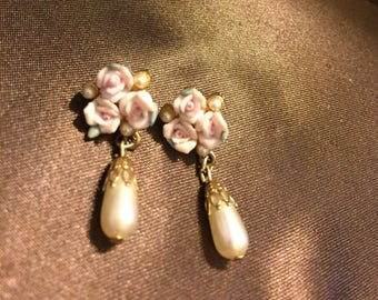 Porcelain flowered earrings with a bead
