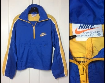 1970's Nike Block Letters Swoosh logo Orange Tag Label made in USA Sports Nylon windbreaker Pullover Jacket size XS Blue Yellow Stripe