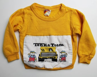 Vintage 80's baby / toddler sweatshirt, Tonka Team, cute cartoon boys and a Tonka Truck, so soft! Yellow with white screen printed patch