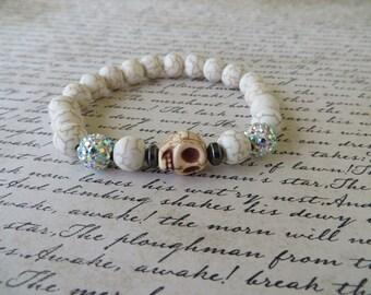 Stretch White Magnesite White Rhinestone And White Howlite Skull Bracelet