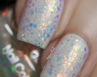 """Nail polish - """"All the Feelings"""" Red to green shifting glitter in a clear base"""