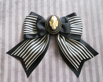 Gothic Lolita hair bow Bat skull cameo on a striped bow