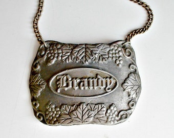 Pewter Brandy Decanter Tag Bacchus Vintage Made In USA Liquor Bottle Label Tag
