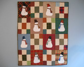 Folksy quilted wall hanging with snowmen and plaids