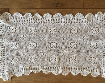 A small, vintage, hand made lace/ crochet doily or tray cloth.