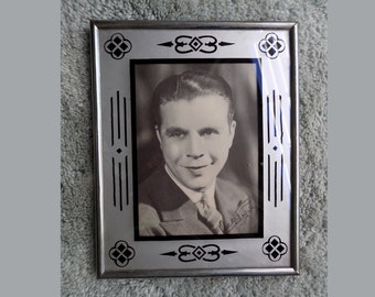 """1930s/40s picture frame with Dick Powell portrait / black design on silver paper / 8"""" x 10"""""""