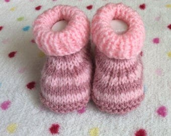 Booties, handknitted to fit newborn.